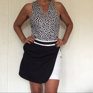 EP PRO BLACK AND WHITE GOLF SKORT SIZE 4